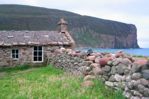 Stone cottage on beach at Hoy