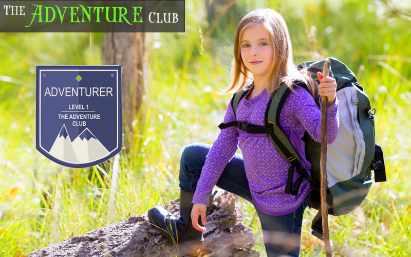 Girl with rucksack, walking stick and Adventurer badge